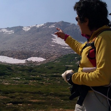 Brenda Avadian pointing toward Mt. Langley