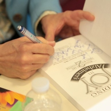 Avadian signing Caregiving Book--Photo Courtesy Bonnie Keith