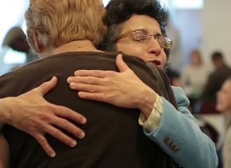 Brenda Avadian comforting a caregiver