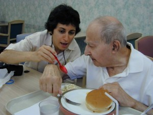 Brenda Avadian teasing her father, Martin during a meal.
