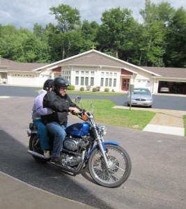 Bell Tower Bucket List- Gerry MacSwain-Butkiewicz riding a motorcycle
