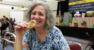 Susan Kraker enjoying a cookie at Face to Face - Web