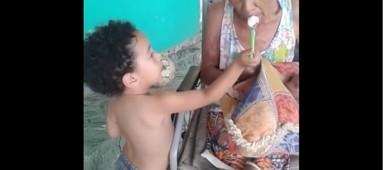 Caregiver Inspiration - Little boy lovingly feeding his elder