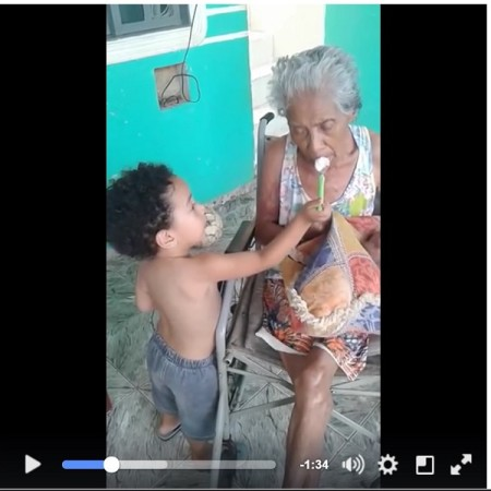 Caregiver Inspiration - Little boy lovingly feeding his elder