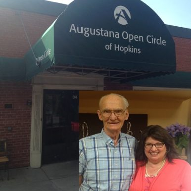 Sheri Zschocher and her husband Bob in front of the Augustana Open Circle Adult Day Services