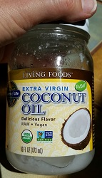 Bottle of extra-virgin Coconut Oil provides ketones - medium chain triglycerides