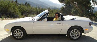 Brenda Avadian sitting in her Miata convertible
