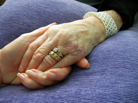 Claire Abel holding her Mom's hand