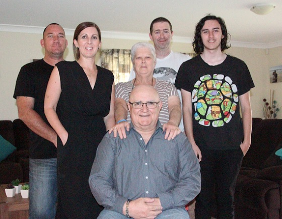 Mick Carmody lives with dementia shown surrounded by his family