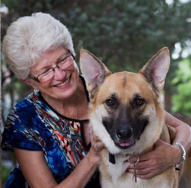 Nany Nelson closeup w dog Levi Voices with Dementia