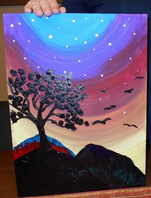 Lyn Purser's painting of a mountain, tree, and birds under the bluish glow of the sun