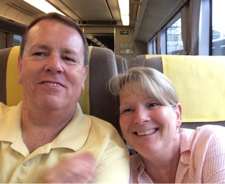 John Sandblom and his wife, Cindy, riding the train in Kyoto, Japan - 2017