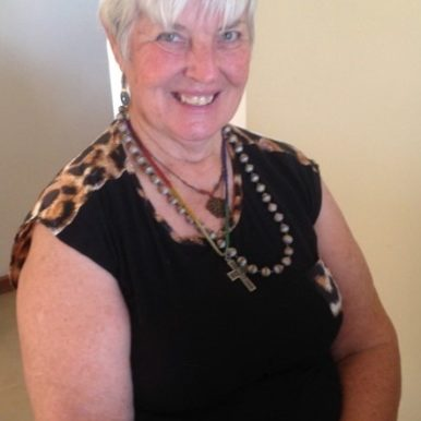 Val Schache of Australia in black sleeveless top with leapard print trim for VOICES with Dementia
