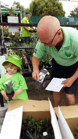 Granddaughter Harper and Alister Robertson working at the Garden Center before he was diagnosed with dementia